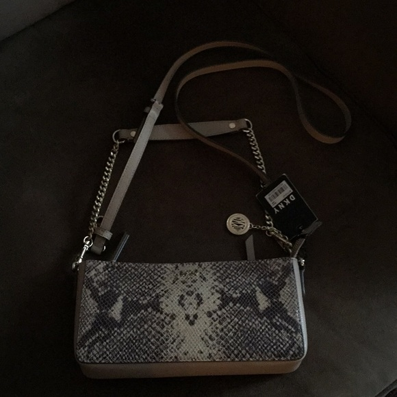 Michael Kors Handbags - ‼️SALE👜DKNY Animal print cross body bag. NWT